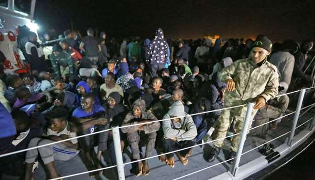 Migrants arrive at a naval base in Tripoli yesterday, after being rescued in the Mediterranean.
