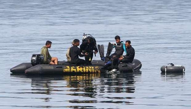 Divers conduct search and retrival operations in Lake Toba