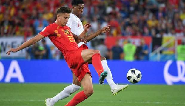 Belgium's midfielder Leander Dendoncker (L) vies with England's forward Marcus Rashford during the R