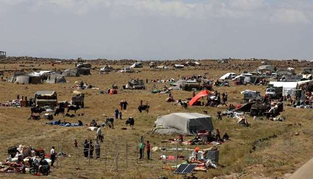 Internally displaced people from Deraa province are gathered near Golan Heights in Quneitra