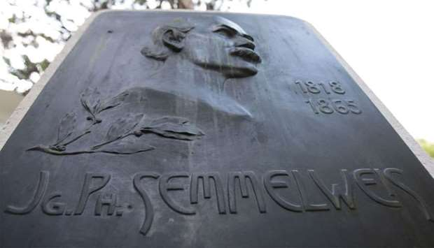 A commemorative plaque for pioneering scientist Ignaz Phillip Semmelweis stands in the garden of the