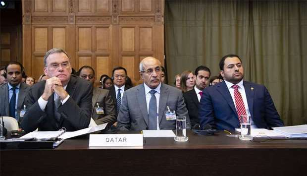 Members of the Qatar delegation on the opening day of the ICJ hearings