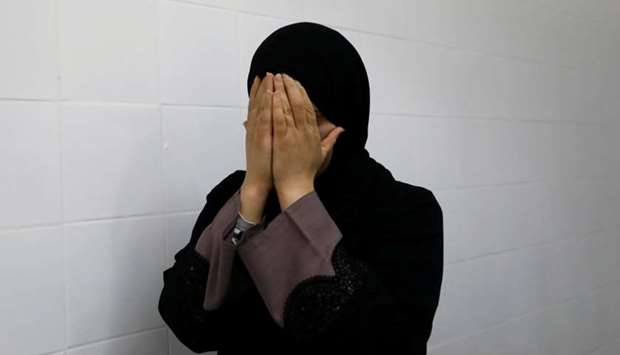 A relative of a Palestinian, who was killed by Israeli troops, reacts at a hospital in Ramallah, in
