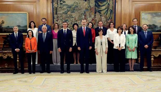 Spain's new cabinet members stand with King Felipe during a swearing-in ceremony at the Zarzuela Pal