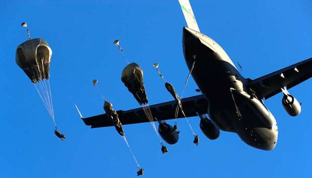 US Army paratroopers leave C-17 aircraft to land during NATO exercise