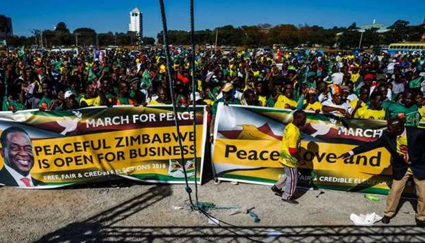 Activists from Zimbabwe's ruling party Zimbabwe African National Union Patriotic Front (ZANU PF) You