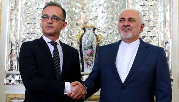 Iran's Foreign Minister Mohammad Javad Zarif (R) receives his German counterpart Heiko Maas in the c
