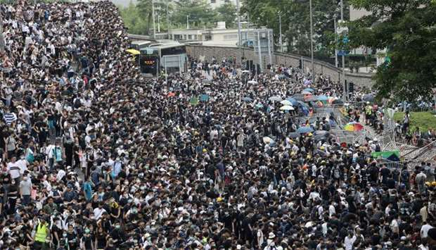 Protesters march along a road demonstrating against a proposed extradition bill in Hong Kong, China