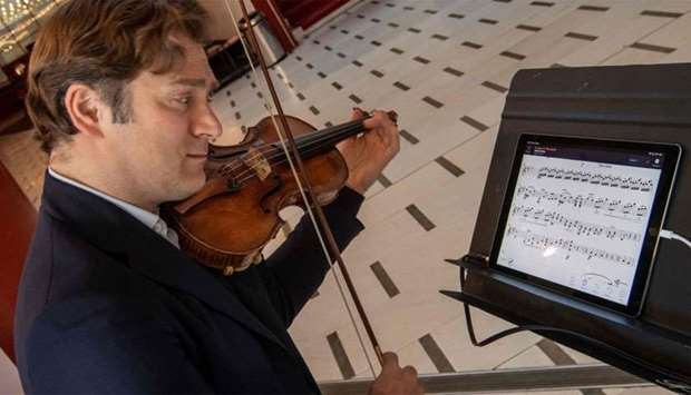 "French violinist Renaud Capucon practices with the new application ""NomadPlay"", created by the Frenc"