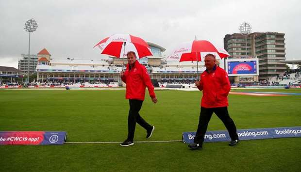 Umpires Marais Erasmus and Paul Reiffel after inspecting the pitch