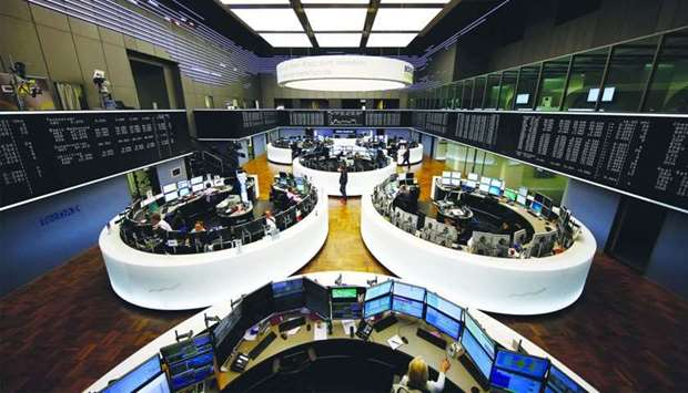 A view of the trading room at the Frankfurt Stock Exchange. The DAX 30 closed 0.4% up at 12,169.05 p