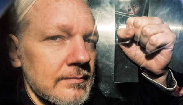 In this file photo taken on May 1, 2019 WikiLeaks founder Julian Assange gestures from the window of