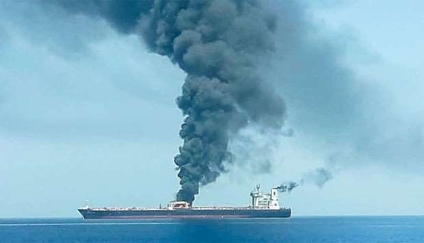 An oil tanker is seen after the explosion at the Gulf of Oman