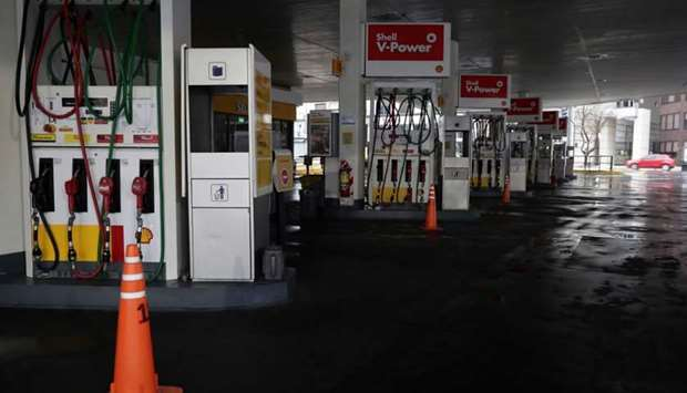 View of a closed gas station in downtown Buenos Aires on June 16, 2019 during a power cut.