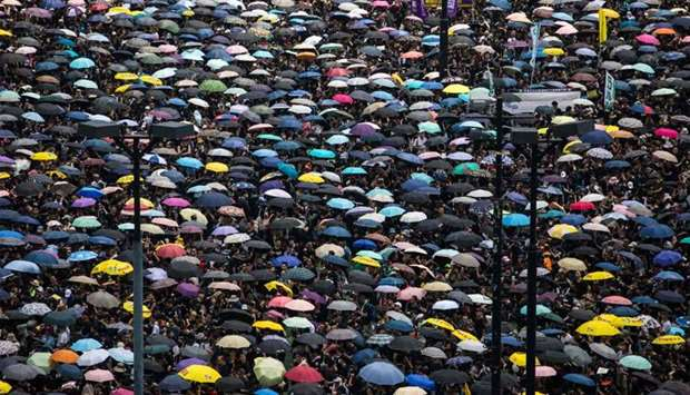 Protesters wearing black and holding umbrellas attend a new rally against a controversial extraditio
