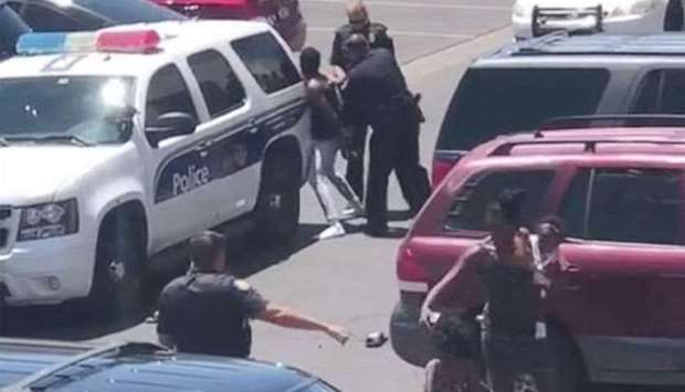 Cell phone video shows officers from the Phoenix Police Department sweep-kicking handcuffed