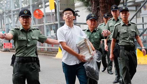 Former student leader Joshua Wong walks out from prison after being jailed for his role in Occupy Ce