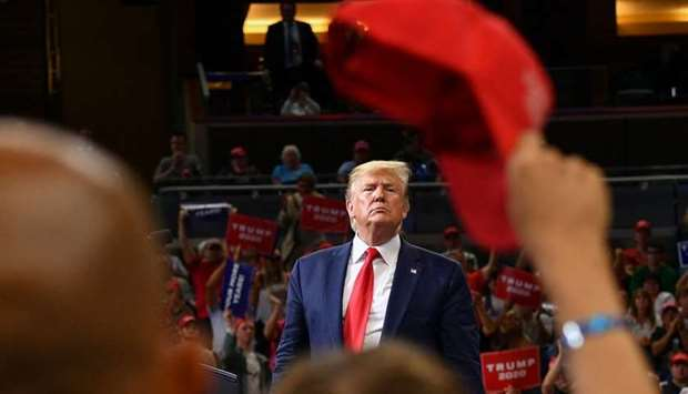 US President Donald Trump speaks during a rally at the Amway Center in Orlando, Florida to officiall