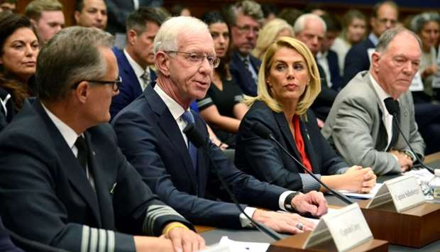 "Retired Airline Captain Chesley ""Sully"" Sullenberger (2nd, L) makes remarks during a House Transport"