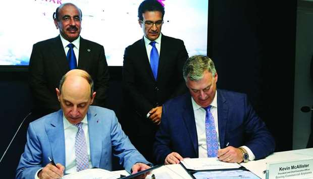 HE al-Baker and Kevin G McAllister, president and CEO of Boeing Commercial Airplanes, sign the agree