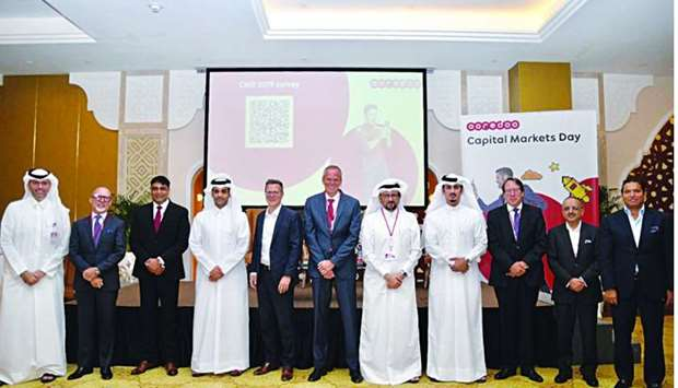 Al-Sayed together with other senior officials during Ooredoo's annual 'Capital Markets Day' held rec