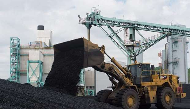 In this file photo taken on April 19, 2017 a front-end loader dumps coal at the East Kentucky Power