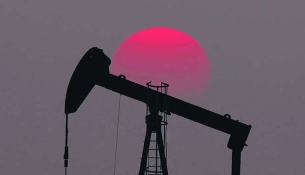 The sun sets behind an oil pump outside Saint-Fiacre, near Paris (file).
