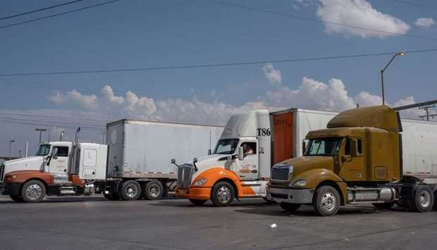 Semi-trucks wait for inspection before crossing the border at the Zaragoza International Bridge, in