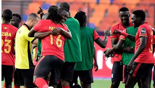 Ugandan players celebrate after winning the 2019 Africa Cup of Nations (CAN) football match between
