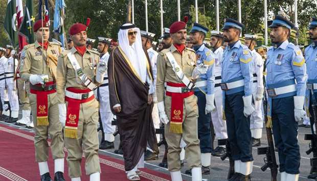 His Highness the Amir Sheikh Tamim bin Hamad Al-Thani inspects a guard of honor during the welcome c