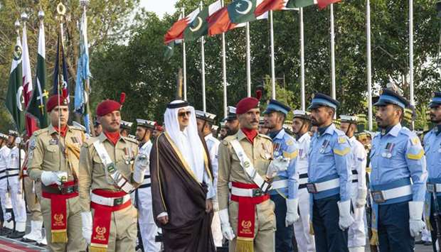 His Highness the Amir Sheikh Tamim bin Hamad Al-Thani inspects a guard of honor