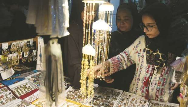 Women browse jewellery at a shop in Karachi ahead of the Eid earlier this month. Officials have said