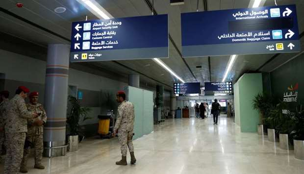 Saudi security officers are seen at Saudi Arabia's Abha airport, after it was attacked by Yemen's Ho