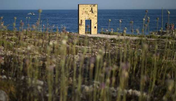 "The ""Door of Europe"" monument, which commemorates migrants who died on their journey, is seen on the"
