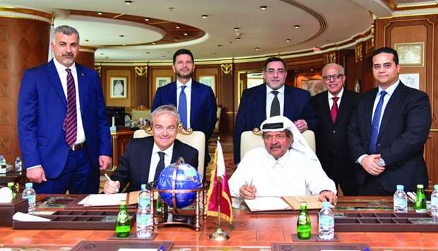 Sheikh Faisal and Rossi sign the agreement in the presence of Salzano and senior Aamal and GPI Group