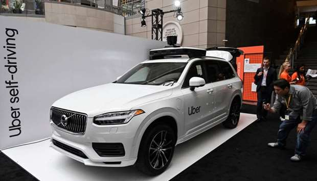 An Uber self-driving Volvo is on exhibit at the Uber Elevate Summit 2019 in Washington, DC