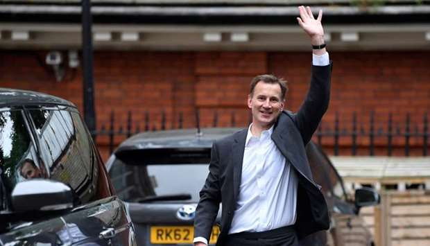 Conservative Party leadership candidate Jeremy Hunt waves as he leaves his home in London, Britain