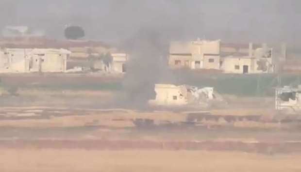 Smoke bellows after an airstrike in Hama province