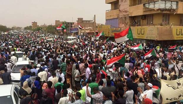 :Sudanese protesters chant slogans demanding civilian rule on June 30, 2019 during a rally in Kharto