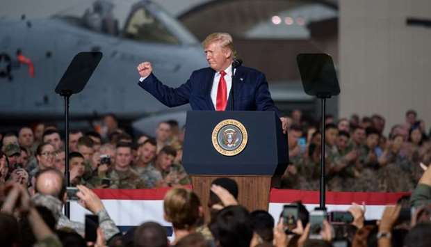 US President Donald Trump gestures during his visit to US troops based in Osan Air Base, South Korea
