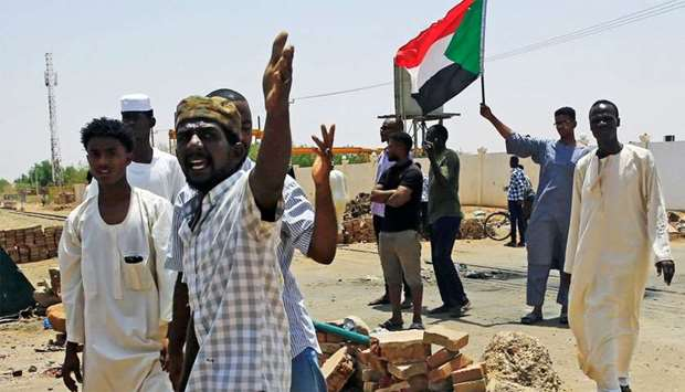 Sudanese protesters set up a barricade on a street, demanding that the country's Transitional Milita