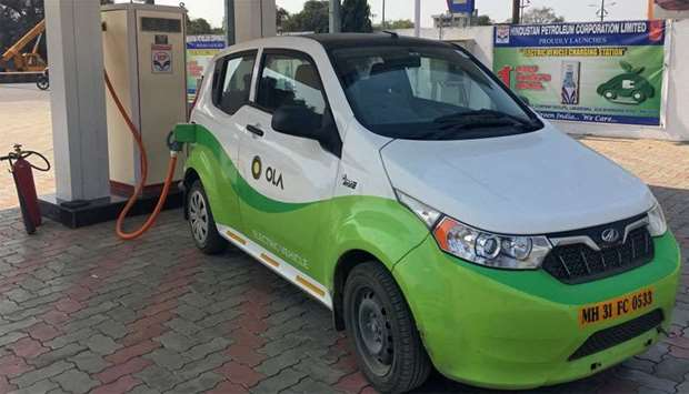 Mahindra's e2oPlus is seen at electric vehicle charging station in Nagpur