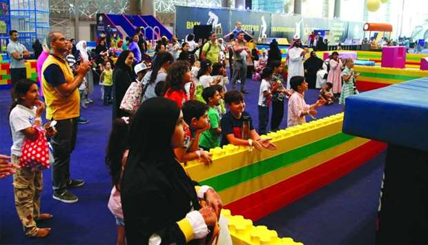 Kids wait for their turn at one of the popular games of 'SEC 2019'. PICTURE: Jayaram