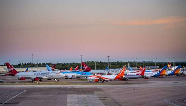 Passenger aircraft, operated by Tui AG, Easyjet, Virgin Atlantic Airways, Jet2 Com, sit grounded on