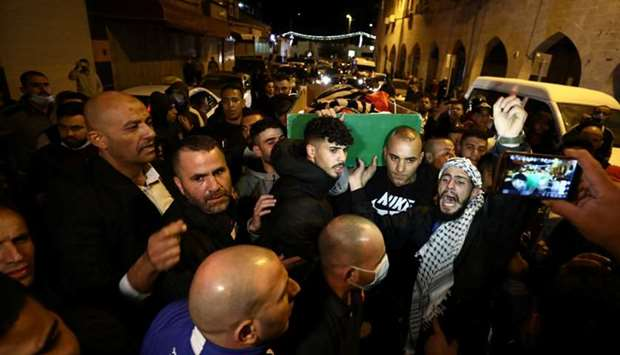 People attend the funeral of Iyad Khayri in Jerusalem.