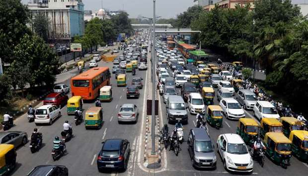 Vehicles are pictured on a road after a few restrictions were lifted during an extended nationwide l