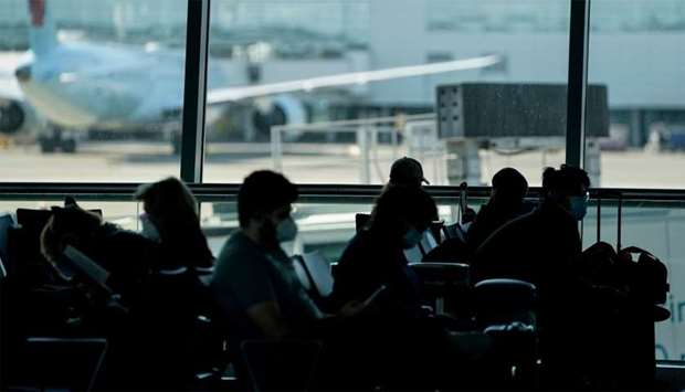 Passengers wait at the boarding gate