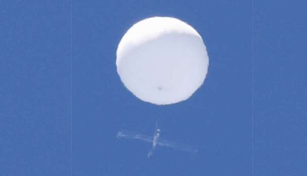 A balloon-like white object in the sky is pictured in Sendai, Japan in this photo taken by Kyodo