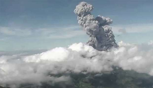The Merapi Mount volcano spewing thick smoke into the air as seen from Yogyakarta