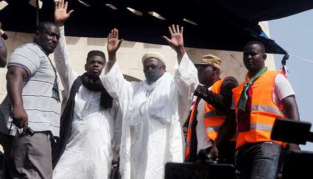 Imam Mahmoud Dicko greets supporters during a protest on Friday, demanding the resignation of Mali's